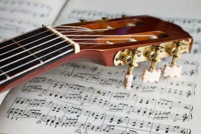 Carta da parati paletta chitarra sulle note di musica