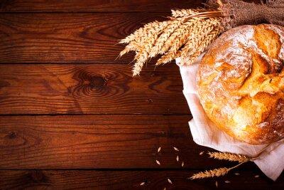 Carta da parati pane fatto in casa su sfondo di legno. stile country. Cottura degli alimenti sfondo