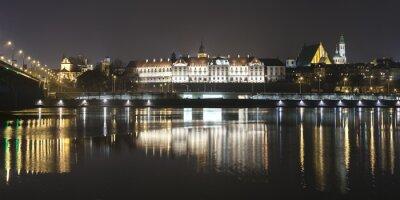 Carta da parati Panoramic view of Warsaw waterfront by night.