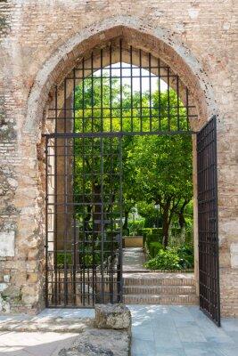 Carta da parati Porta ai giardini del Alcazar a Cordoba