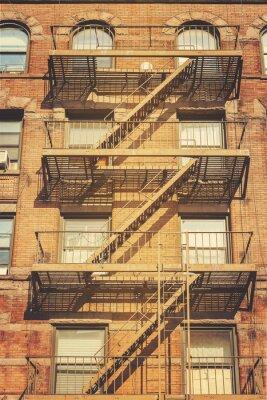 Carta da parati Retro foto di stile di edificio con scale antincendio, New York.