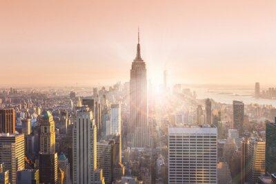Carta da parati skyline di Manhattan New York City nel tramonto.