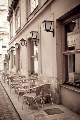 Carta da parati Tavoli e sedie in un caffè