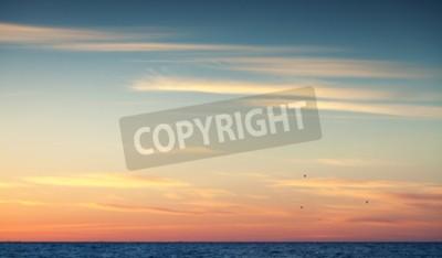 Carta da parati tramonto cielo colorato sopra l'oceano Atlantico, sfondo naturale foto con filtro di correzione foto tonalità calda