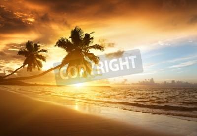Carta da parati tramonto sulla spiaggia del Mar dei Caraibi