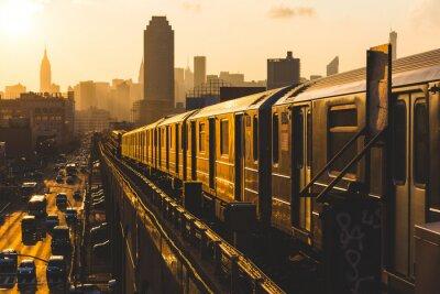 Carta da parati Treno della metropolitana di New York al tramonto