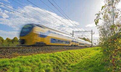 Carta da parati Treno guidando verso il sole in autunno