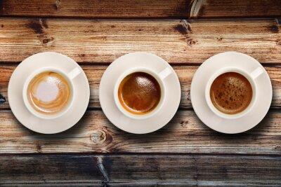 Carta da parati tris di caffè su fondo Legno