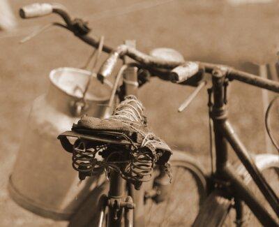 Carta da parati vecchia bicicletta del secolo scorso, utilizzato per il trasporto del latte di Mi