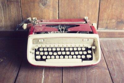Carta da parati Vecchio stile macchina da scrivere su un pavimento di legno