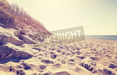 Carta da parati Vintage tonica immagine di una spiaggia al tramonto.