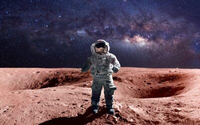 Poster astronauta coraggioso alla passeggiata spaziale sui Marte. Questi elementi immagine fornita dalla NASA.