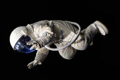 Poster astronauta su sfondo nero
