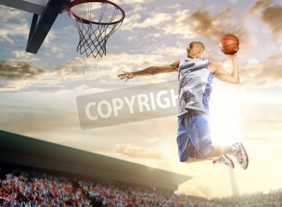 Poster Basketball player in action on background of sky and crowd