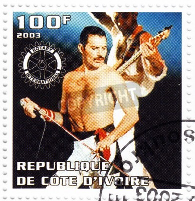 Poster BENIN - CIRCA 2003   Stamp printed in Benin shows Freddie Mercury leader the Queen - 1980s famous musical pop group, circa 2003