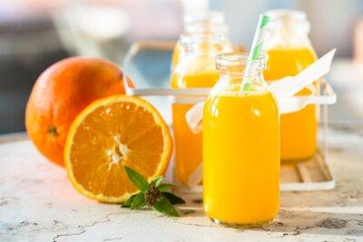 Poster bottiglia di succo d'arancia