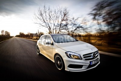 Poster Bucharest, Romania - March 19, 2013: A Mercedes-Benz A 200 Sport AMG Line is pictured on a roasd in Bucharest, Romania. The A-Class is a small family car, produced by the German automobile manufacture