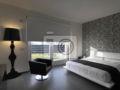 Camera da letto moderna con poltrona in pelle nera manifesti da muro ...