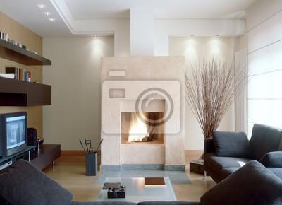 Camino in moderno soggiorno con divano grigio manifesti da muro ...