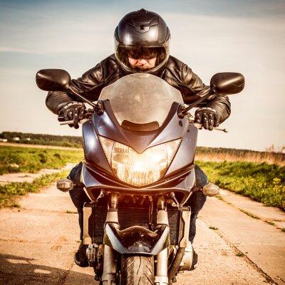 Poster corsa del motociclista sulla strada