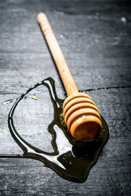 Poster Cucchiaio di legno di dolce miele naturale.