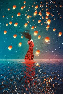 Poster donna in abito in piedi su acqua contro lanterne galleggianti in un cielo notturno, illustrazione pittura