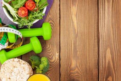 Poster Dumbells, metro e cibo sano sul tavolo in legno
