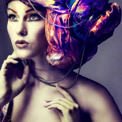 Poster Foto di una bella ragazza in un testa-abito dal tessuto colorato