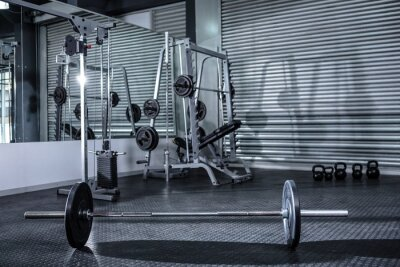 Poster Heavy barbell in empty room