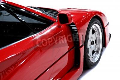 Poster L'estremità laterale e anteriore di una vettura sportiva rossa