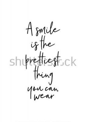 Poster Lettere disegnate a mano. Illustrazione di inchiostro Moderna calligrafia pennello Isolato su sfondo bianco Un sorriso è la cosa più carina che puoi indossare.