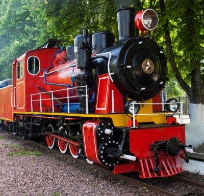 Poster locomotiva a vapore che soffia via il vapore