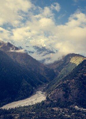 Poster Montagne che sovrasta valle.