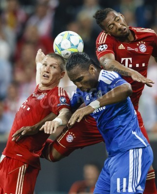 Poster MUNICH, May 19 - Drogba of Chelsea (M) between Schweinsteiger (L) and Boateng (R) of Bayern during FC Bayern Munich vs. Chelsea FC UEFA Champions League Final game at Allianz Arena on May 19, 2012 in