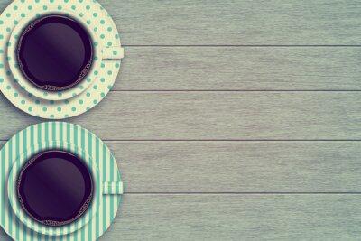 Poster paio di tazze di caffè sul tavolo in legno