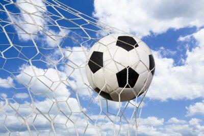 Poster pallone da calcio in rete di obiettivo