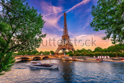 Poster Paris Eiffel Tower and river Seine at sunset in Paris, France. Eiffel Tower is one of the most iconic landmarks of Paris.