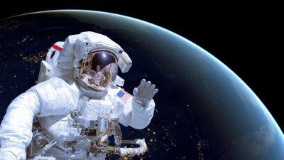 Poster Primo piano di un astronauta nello spazio, la terra di notte in background. Elementi di questa immagine sono fornite dalla NASA