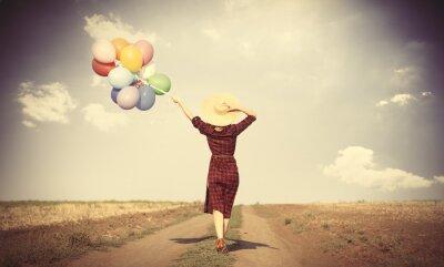 Poster ragazza con palloncini multicolori e borsa