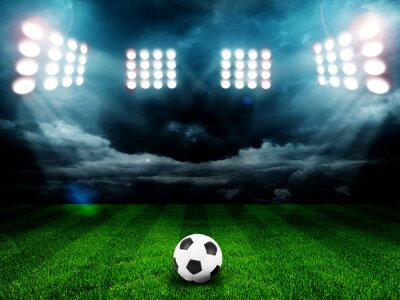 Poster Soccer ball on the field of stadium with light