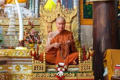 Poster The wax figure of Buddhist monk in meditation sitting position, Wang Wiwekaram Temple, Sangkla buri, Thailand