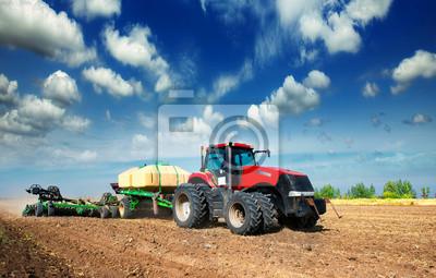 Poster trattore in un campo