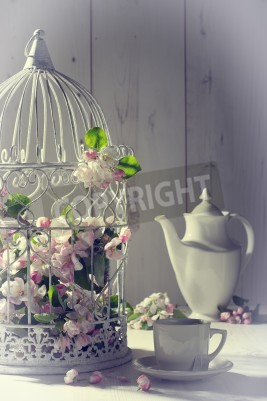 Poster Vintage afternoon tea with birdcage filled with spring blossom