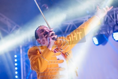 Poster Yateley, UK - June 30, 2012: Professional Freddie Mercury tribute artist Steve Littlewood performing at the GOTG Festival in Yateley, UK