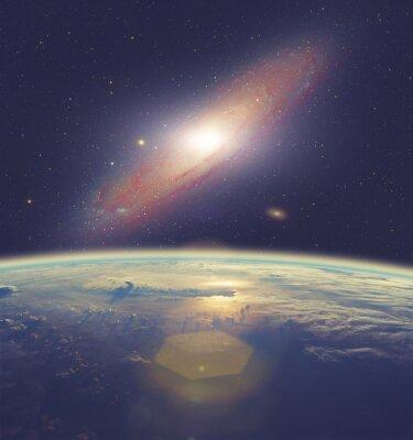 Quadro Alba sopra la Terra con grande galassia di Andromeda.