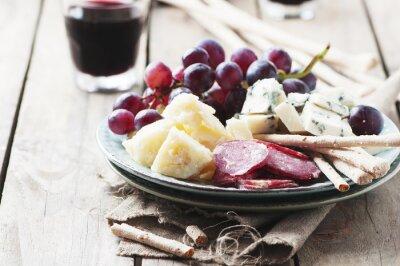 Quadro Antipasto con formaggi, salumi e uva