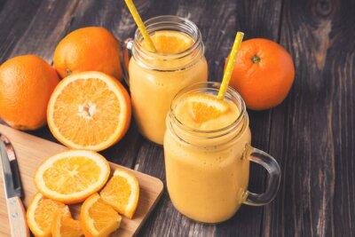 Quadro Arancione frullato di frutta nei vasi di vetro