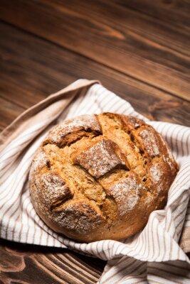 Quadro Assortimento del pane sulla superficie di legno