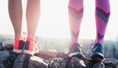 Quadro athlete running sport feet on trail healthy lifestyle fitness