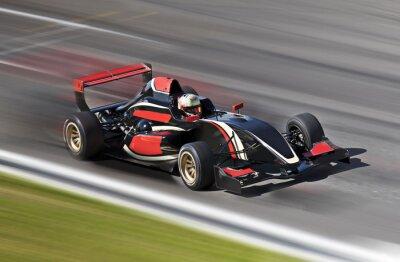 Quadro Auto da corsa gara di F1 su una pista con motion blur